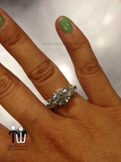 engagement-ring-on-black-hand