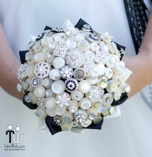 ivory-silver-black-brooch-and-button-wedding-bouquet.full